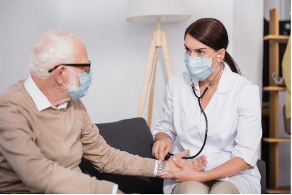 A nurse checking a patient's pulse.