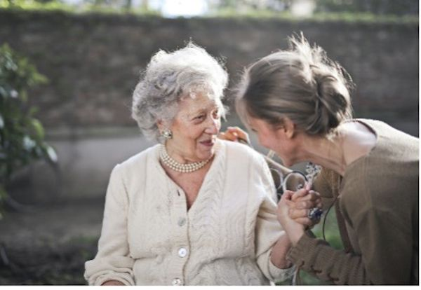 Two women talking and smiling.