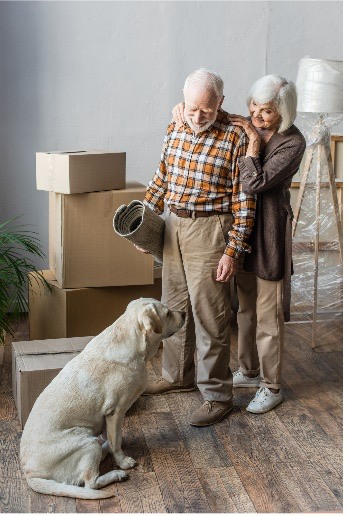 An older couple and their dog.
