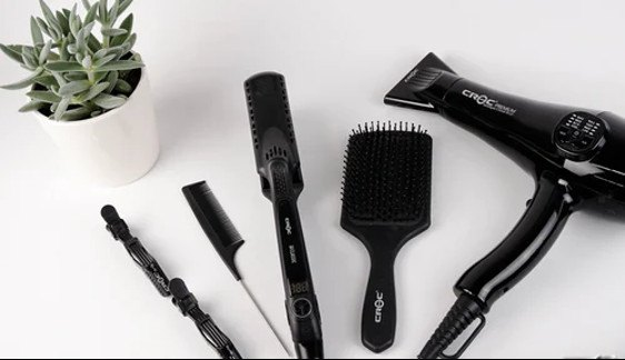 A brush, comb, some hair clips, hair straightener, and a blow driver.